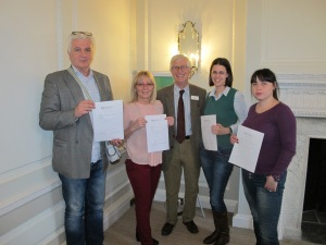 Dragoljub, Nada, Zeljka and Ena receive their certificates from Peter Tyrer at the end of their training